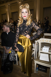 Paloma Faith polished off her glamorous look with a beaded black fan-shaped clutch.