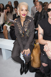 Rita Ora went the androgynous route in an embroidered gray button-down and matching pants when she attended the Hunter Original fashion show.