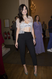 Daisy Lowe avoided a too-risque look by teaming her top with black capri pants.