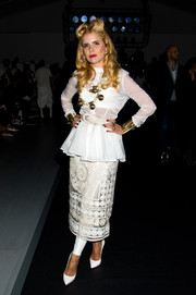 Paloma Faith teamed her blouse with an embroidered, sheer white pencil skirt and a pair of leggings.