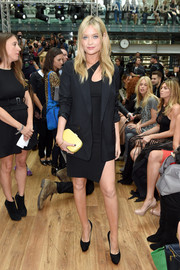 Laura Whitmore attended the Julien Macdonald fashion show looking stylish in a black boyfriend blazer layered over an asymmetrical LBD.