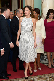 Queen Letizia of Spain looked youthful and breezy in a dotted halter dress by Carolina Herrera while touring the Dominican Republic.