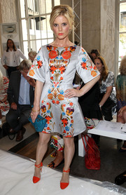 Emilia Fox charmed at the Temperley London fashion show in a cocktail dress with a lovely floral print.