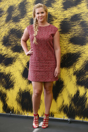 Amy Schumer looked just like a little girl in a pin-dot mini dress teamed with a side braid during day 4 of the Locarno Film Festival.