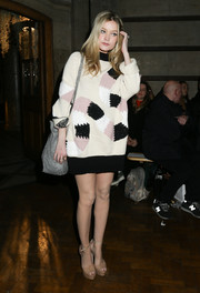 Laura Whitmore looks comfy cute at the GILES show in an oversized sweater-dress during London Fashion Week Fall/Winter 2015.