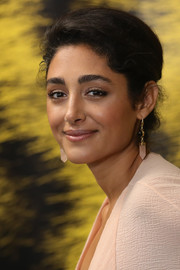 Golshifteh Farahani attended the Locarno Film Festival photocall for 'The Song of Scorpions' wearing a classic loose bun.
