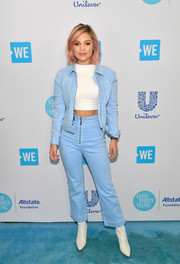 Olivia Holt layered a Juicy Couture denim jacket over a white crop-top for WE Day California.