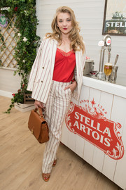 Natalie Dormer teamed a striped pantsuit with a red silk top for the Championships, Wimbledon event.