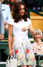 Kate Middleton was all abloom in a floral mini dress by Catherine Walker during the Wimbledon final.