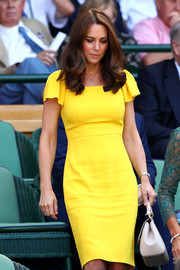 Kate Middleton was hard to miss in this canary-yellow flutter-sleeve dress by Dolce & Gabbana during Wimbledon 2018.