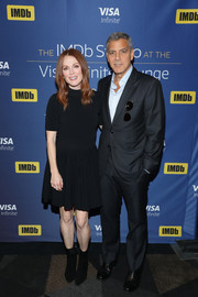 Julianne Moore chose a pair of black suede ankle boots to finish off her look.