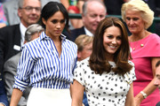 Meghan Markle was casual-chic in a blue and white striped shirt by Ralph Lauren at Wimbledon 2018.