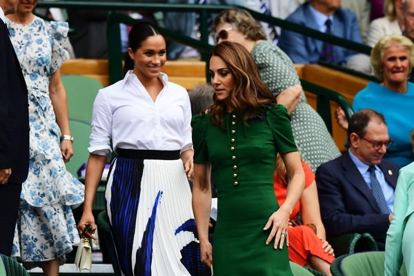 Meghan Markle paired a Hugo Boss print skirt with a white button-down for day 12 of Wimbledon 2019.