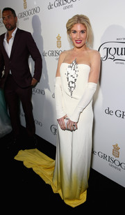 For her De Grisogono party look, Hofit Golan chose an embellished white sheer-panel gown that flowed down to a yellow train.