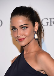 Ana Beatriz Barros made a simple ponytail look oh-so-sexy when she attended the de Grisogono party.