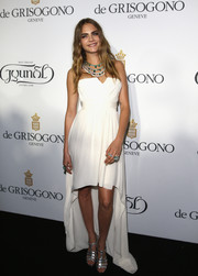 Cara Delevingne paired her dress with classic silver strappy sandals.