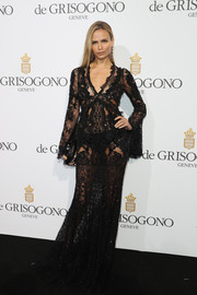 Natasha Poly displayed plenty of skin in a sheer black lace gown during the De Grisogono party.