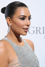Kim Kardashian went all out with the sparkle, pairing massive diamond earrings with her chainmail dress.