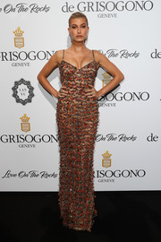Hailey Baldwin was svelte and chic in a fully embellished column dress by Roberto Cavalli at the De Grisogono Love on the Rocks party.
