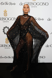 Elsa Hosk grabbed attention in a sheer, beaded black gown by Alberta Ferretti at the De Grisogono Love on the Rocks party.