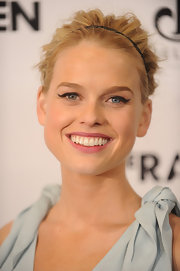 Alice Eve was as pretty as a picture at a special screening of 'The Raven.' She created her ultra-feminine look with simple sweeps of black liner, rosy pink lipstick and a sweet slim headband.