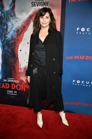 Gina Gershon teamed a trenchcoat with a cowl-neck top and harem pants for the New York premiere of 'The Dead Don't Die.'