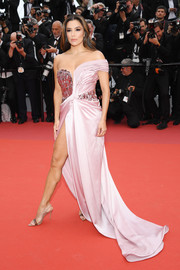 Eva Longoria turned heads in a high-slit pink off-the-shoulder gown by Alberta Ferretti Limited Edition Couture at the 2019 Cannes Film Festival opening ceremony.