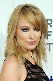 Olivia Wilde attended the Tribeca Film Festival premiere of 'Deadfall' wearing a pair of brass triangle earrings