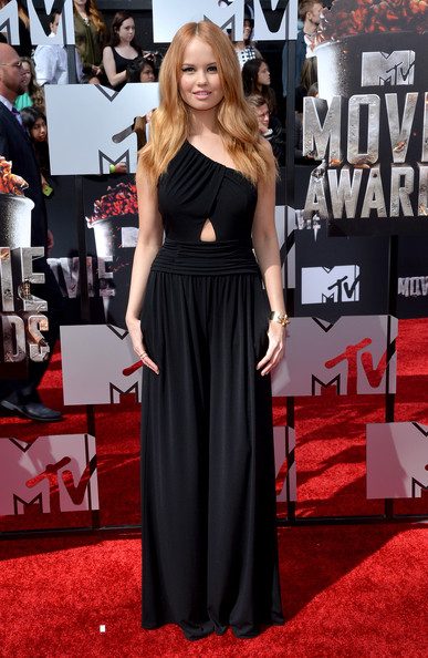 Debby Ryan Jumpsuit [dress,red carpet,clothing,carpet,premiere,shoulder,gown,flooring,fashion,event,arrivals,debby ryan,mtv movie awards,nokia theatre l.a. live,los angeles,california]