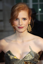 Jessica Chastian looked lovely at the 'The Debt' premiere. Her hair was swept back to the nape of the neck and then twisted vertically up to the crown and pinned into place. A large, face-framing section was left out of the twist and curled to create a pretty wave.