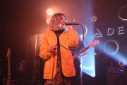 Julia Michaels performed at the Delta Air Lines Grammy Weekend celebration wearing a quilted orange jacket.