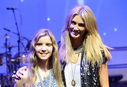 Delta Goodrem accessorized with a lovely coral teardrop pendant necklace at the 'Evening with Delta' photocall.