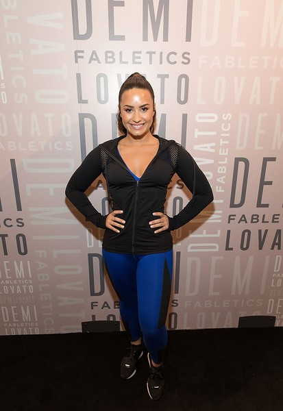 Demi Lovato Crosstrainers [fashion,electric blue,shoulder,footwear,carpet,fashion design,photography,flooring,performance,shoe,demi lovato,legacy west,plano,texas,fabletics,demi lovato visits fabletics]