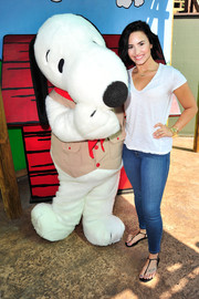 Demi Lovato went super casual in a white V-neck tee and blue skinny jeans for her birthday celebration at Knott's Berry Farm.