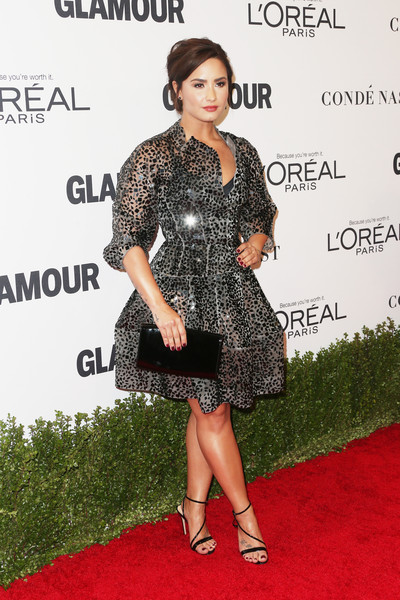 Demi Lovato Patent Leather Clutch [clothing,red carpet,dress,carpet,cocktail dress,hairstyle,premiere,flooring,fashion,footwear,arrivals,demi lovato,neuehouse hollywood,los angeles,california,glamour women of the year]