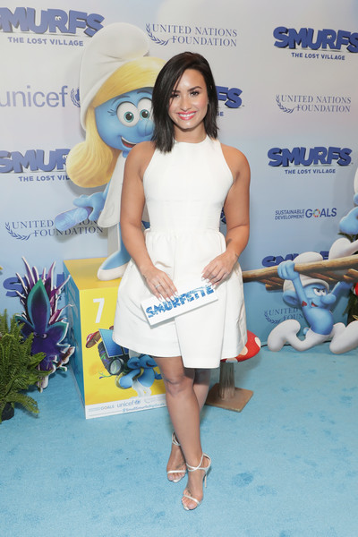 Demi Lovato Printed Clutch [smurfs: the lost village celebrate international day of happiness,clothing,yellow,cocktail dress,dress,leg,fashion,shoulder,footwear,joint,thigh,demi lovato,actress,conjunction,smurfs,united nations headquarters,the lost village,new york city,un,international day of happiness]