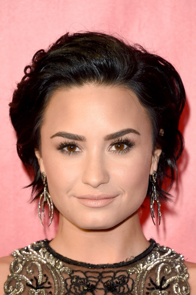 Demi Lovato Dangling Diamond Earrings [hair,face,eyebrow,hairstyle,chin,beauty,forehead,black hair,lip,cheek,musicares person of the year,los angeles,california,los angeles convention center,demi lovato,lionel richie - arrivals,lionel richie]