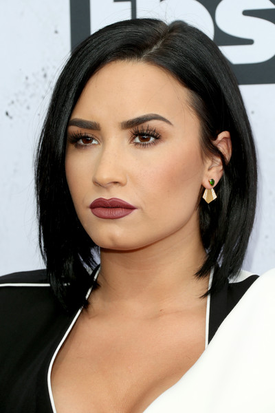 Demi Lovato Gold Dangle Earrings [hair,face,eyebrow,hairstyle,lip,chin,black hair,shoulder,beauty,skin,arrivals,demi lovato,actress,iheartradio music awards,inglewood,california,the forum]