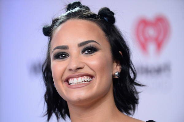 Demi Lovato Sterling Studs [hair,eyebrow,face,hairstyle,facial expression,lip,forehead,smile,chin,black hair,demi lovato,backstage,las vegas,nevada,mgm grand garden arena,iheartradio music festival]