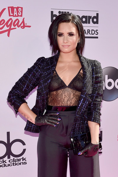 Demi Lovato Leather Gloves [clothing,hairstyle,carpet,outerwear,premiere,flooring,long hair,black hair,singer,brown hair,arrivals,demi lovato,billboard music awards,t-mobile arena,las vegas,nevada]