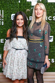 Kate Hudson attended the launch of Fabletics Capsule Collection carrying a blue hard-case clutch by Edie Parker.