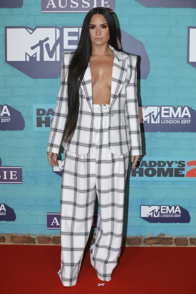 Demi Lovato Pantsuit [clothing,plaid,red carpet,hairstyle,carpet,pattern,fashion,outerwear,design,pantsuit,red carpet arrivals,emas 2017,demi lovato,sse arena,london,england,wembley,mtv]