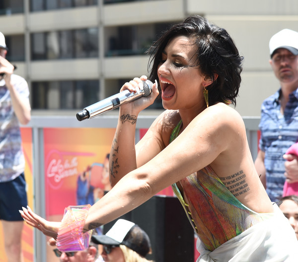 Demi Lovato Lettering Tattoo [arm,event,performance,human body,fun,singer,street performance,singing,trunk,musician,demi lovato,california,los angeles,watermarke tower,kiis fm,pool party,cool for the summer pool party]