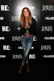 Erin Wasson pulled her look together with a pair of brown suede ankle boots.