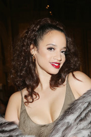 Dascha Polanco attended the Dennis Basso fashion show wearing her hair in half-up curls.