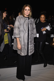 Olivia Palermo paired her fur with black wide-leg pants by Milly.