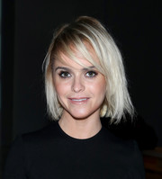 Taryn Manning attended the Deola Sagoe/Clan fashion show rocking a messy 'do with emo bangs.