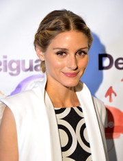 Olivia Palermo topped off her look with a demure braided updo when she attended the Desigual fashion show.