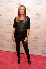 Nina Garcia made pregnancy look fab with this studded black maternity top.