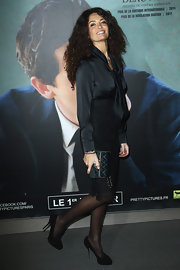 Afef Jnifen arrived at the Paris premiere of 'Detachment' in elegant black evening pumps.
